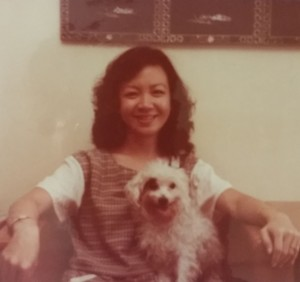 My sister with Patchy our first beloved dog in our HUDC flat.