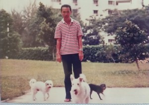 Dad bringing Patchy, Rusty and Jamie out for their daily walk at the foot of our block.